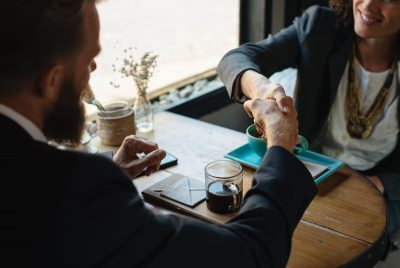 Augean lady and man shaking hands