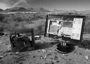 Old computer screen and TV in desert