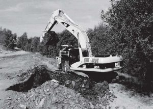 Soil being dug out of ground by machinery